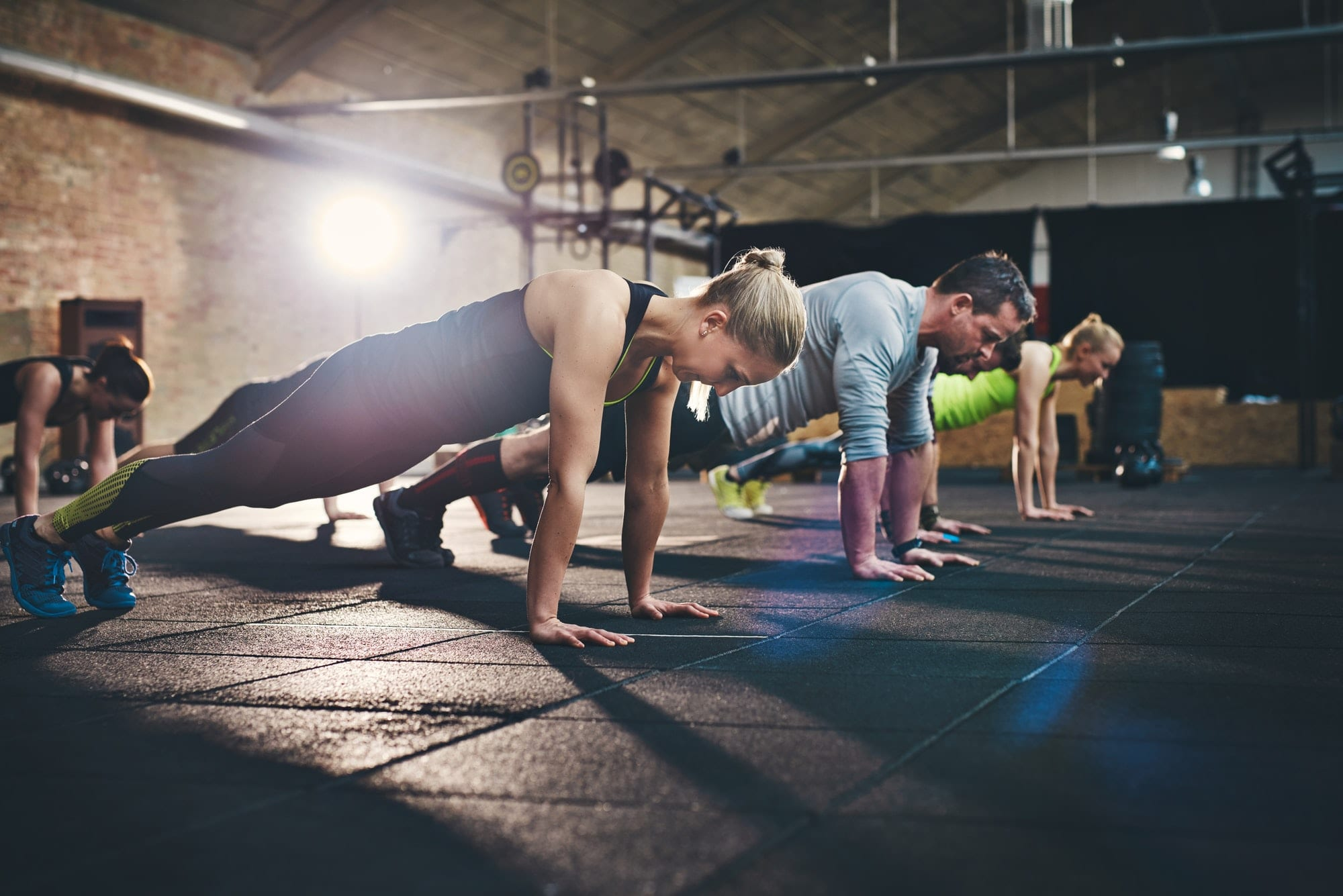 Group of adults doing push up exercises